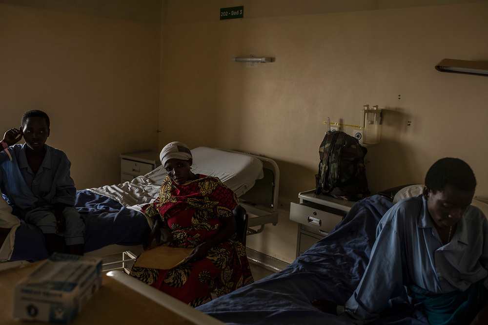 Christine Mukanzayirambaho, 16, her mother, Joseline Nyirandihoreye, and Peninah Nyiracyiza, 36 wait in their beds during the pre-operation period at King Faisal Hospital in Rwanda.<br /> <br /> Rheumatic heart disease is damage to one or more heart valves that stems from inadequately treated strep throat. Left untreated, rheumatic heart disease leads to heart failure. Left untreated, rheumatic heart disease leads to heart failure.