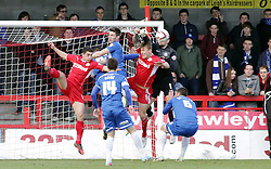 Peterborough United's Robert Olejnik clears the ball from Crawley Town's Kyle McFadzean - Photo mandatory by-line: Joe Dent/JMP - Tel: Mobile: 07966 386802 01/03/2014 - SPORT - FOOTBALL - Crawley - Broadfield Stadium - Crawley Town v Peterborough United - Sky Bet League One
