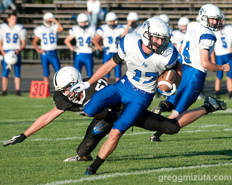 LaGrande senior runningback Erik Jacobs avoids a backfield tackle by Cody Collins  during the season opening Vale-LaGrande game at Vale High School's Frank Hawley Stadium in Vale, OR on September 2, 2011. LaGrande won the game 25-19.