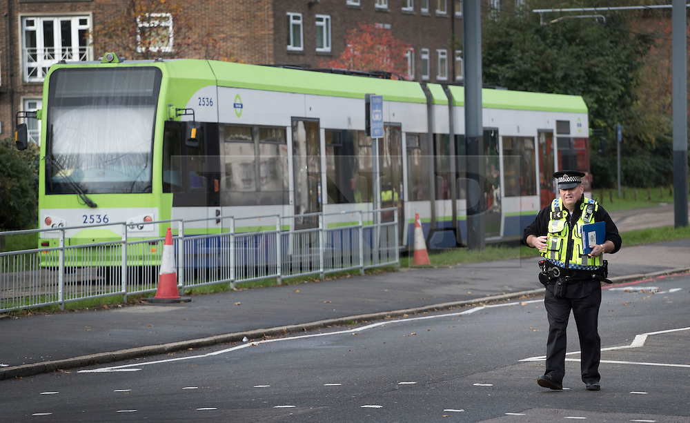 © Licensed to London News Pictures. 10/11/2016. Croydon, UK. A British Transport policeman walks past a tram just outside Sandilands tram station. Investigations are continuing into a tram crash that police say claimed seven lives and injured 50. The driver has been arrested and is being questioned by police. Photo credit: Peter Macdiarmid/LNP