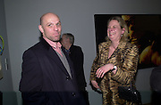 Peter Doig and Louisa Buck. Whitechapel art Gallery. Centenary exhibition. private view. © Copyright Photograph by Dafydd Jones 66 Stockwell Park Rd. London SW9 0DA Tel 020 7733 0108 www.dafjones.com