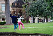 Mature couple practising Tai Chi in Hyde Park, Sydney, Australia