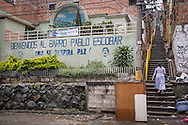 """2015/11/19 - Medellín, Colombia: Welcome to Barrio Palbo Escobar! Originally called """"Medellin Sin Tugurios,"""" or Medellin Without Shanty Towns, Barrio Pablo Escobar is located high up on the eastern slope of Medellin, where Pablo Escobar built 413 houses, which he gave to poor people that used to live in a mountain of garbage in the Moravia barrio. (Eduardo Leal)"""