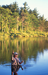 Freedom, NH..Fly-fishing in Trout Pond in New Hampshire's Lakes Region.  Hip waders.  Part of future town forest.