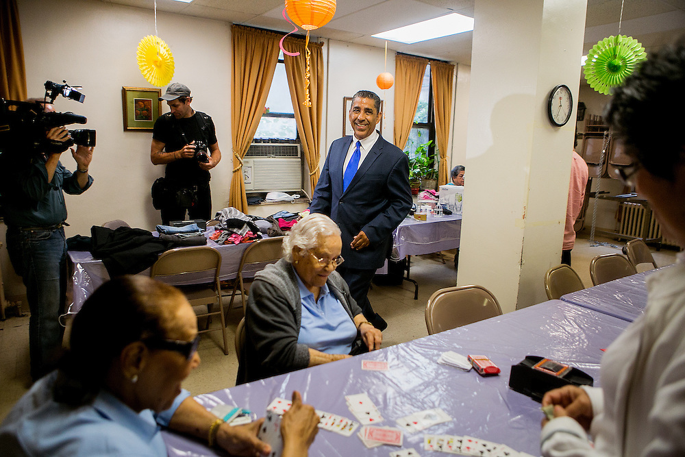 NEW YORK, NY - JUNE 28, 2016: Congressional candidate and New York State Senator Adriano Espaillat greets residents at the R.A.I.N. Senior Center in New York, New York. CREDIT: Sam Hodgson for The New York Times.