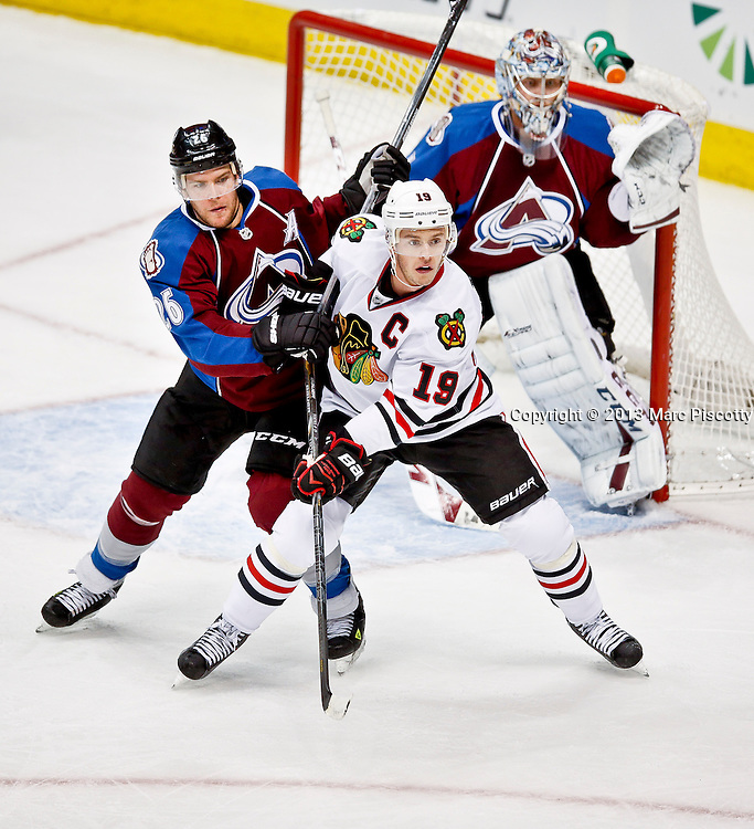 SHOT 11/19/13 8:28:59 PM - Paul Stastny #26 of the Colorado Avalanche tries to move Jonathan Toews #19 of the Chicago Blackhawks  from in front of the net during their regular season NHL game at the Pepsi Center in Denver, Co. on Tuesday November 19, 2013. The Avalanche won the game 5-1. (Photo by Marc Piscotty / © 2013)
