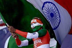 August 12, 2017 - Colombo, Sri Lanka - An Indian supporter waves the Indian national flag during the 1st Day's play in the 3rd Test match between Sri Lanka and India at the Pallekele International cricket stadium, Kandy, Sri Lanka on Saturday 12 August 2017. (Credit Image: © Tharaka Basnayaka/NurPhoto via ZUMA Press)