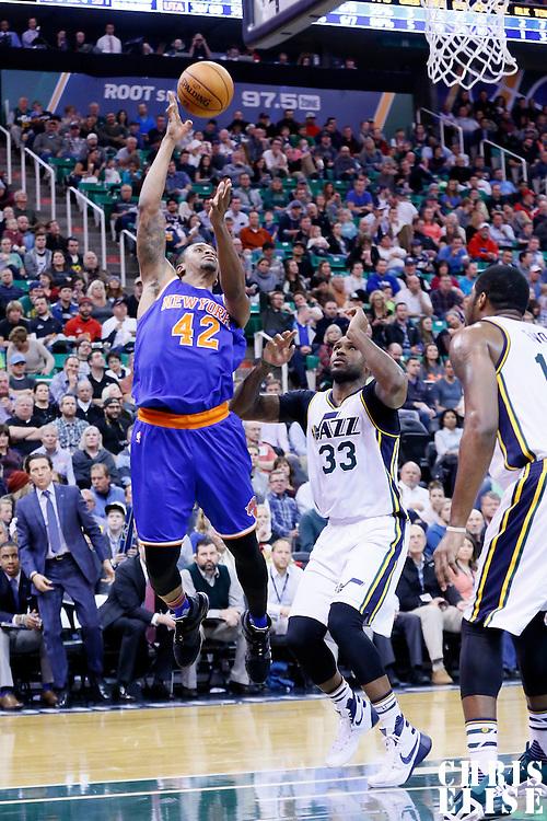 09 December 2015: New York Knicks forward Lance Thomas (42) goes for the baby hook over Utah Jazz forward Trevor Booker (33) during the Utah Jazz 106-85 victory over the New York Knicks, at the Vivint Smart Home Arena, Salt Lake City, Utah, USA.