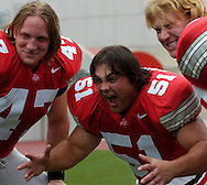 Ohio State linebackers (from left) A.J. Hawk, Anthony Schlegel and Bobby Carpenter get a little silly while being photographed during Ohio State's photo day in Columbus.