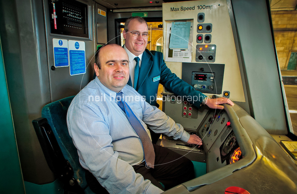BBC Radio Humberside's Andy Comfort has a go at train driving for Hull Trains. 13 March 2002, Hull Paragon Station