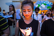20 MAY 2014 - BANGKOK, THAILAND: A Thai woman holds a candle during a vigil against martial law. About 200 Thais gathered at the Bangkok Art and Culture Centre in central Bangkok to protest the army's decision to impose martial law.   PHOTO BY JACK KURTZ