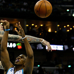 Dec 18, 2009; New Orleans, LA, USA;  New Orleans Hornets guard Chris Paul (3) has his shot blocked by Denver Nuggets center Chris Andersen (11) during the first quarter at the New Orleans Arena. Mandatory Credit: Derick E. Hingle-US PRESSWIRE