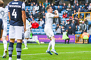Leeds United defender Ezgjan Alioski (10) scores a goal and celebrates to make the score 2-1 during the EFL Sky Bet Championship match between Millwall and Leeds United at The Den, London, England on 5 October 2019.