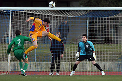 Liuiu Ganea of Romania  vs Goalkeeper of Slovenia Jan Koprivec during Friendly match between U-21 National teams of Slovenia and Romania, on February 11, 2009, in Nova Gorica, Slovenia. (Photo by Vid Ponikvar / Sportida)