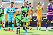 Forest Green Rovers Joseph Mills(23) and match day mascot during the EFL Sky Bet League 2 match between Forest Green Rovers and Newport County at the New Lawn, Forest Green, United Kingdom on 31 August 2019.