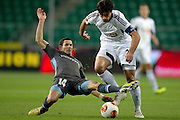 (R) Legia's Ivica Vrdoljak fights for the ball with (L) Apollon's Camel Meriem during the UEFA Europa League Group J football match between Legia Warsaw and Apollon Limassol FC at Pepsi Arena Stadium in Warsaw on October 03, 2013.<br /> <br /> Poland, Warsaw, October 03, 2013<br /> <br /> Picture also available in RAW (NEF) or TIFF format on special request.<br /> <br /> For editorial use only. Any commercial or promotional use requires permission.<br /> <br /> Mandatory credit:<br /> Photo by &copy; Adam Nurkiewicz / Mediasport