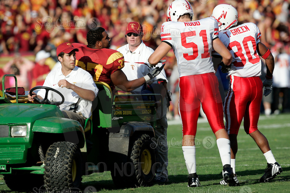 16 September 2006: Bo Ruud and Tierre Green shake hands with Ryan Powdrell while he is taken off the field with a leg injury in the first quarter of the USC Trojans college football home opener against the Nebraska Cornhuskers with a 28-10 win over the Big-12 team at the Los Angeles Memorial Coliseum in CA.