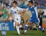 Picture by Ady Kerry/Focus Images Ltd.  .26/09/09.Gillingham's Jack Payne challenges Norwich's Wes Hoolahan during their Coca-Cola League 1 game at the Priestfield Stadium, Gillingham, Kent
