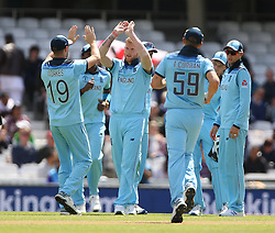 England's Ben Stokes (centre) celebrates after taking the wicket of Afghanistan's Noor Ali Zadran during the ICC Cricket World Cup Warm up match at The Oval, London.