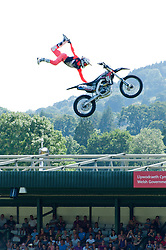 © Licensed to London News Pictures. 23/07/2019. Llanelwedd, Powys, UK. Bolddog Lings Freestyle Motorcycle Team put on an amazing display on the second day of the 100th Royal Welsh Agricultural Show. Founded in 1904, the Royal Welsh Agricultural Show is hailed as the largest and most prestigious event of its kind in Europe, with in excess of 200,000 visitors usually expected for the annual four day show period. Photo credit: Graham M. Lawrence/LNP