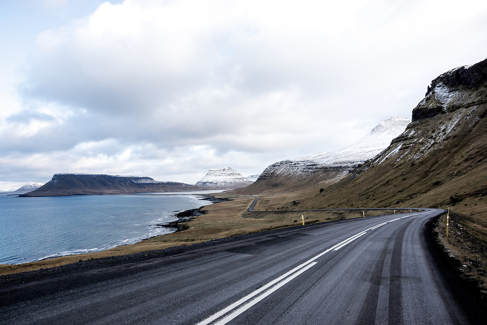 Iceland famous ring road. The most beautiful stretch of road.  You'll see sheep along the way. Stop in a small town and enjoy a great meal.