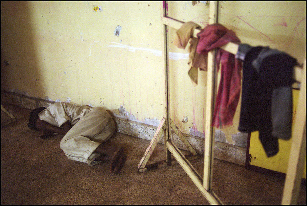 INDIA. Mumbai (Bombay). 2002. Child sleeping on the floor inside the shelter.