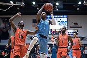 San Diego Toreros guard Braun Hartfield (1) goes in for a layup against Cal State Fullerton Titans guard Austen Awosika (10) during an NCAA basketball game, Wednesday, Dec. 11, 2019, in Fullerton, Calif. San Diego defeated CSUF 66-54. (Jon Endow/Image of Sport)