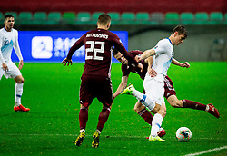 LJUBLJANA, SLOVENIA - NOVEMBER 16:  Raivis Jurkovskis  of Latvia and Jaka Bijol  of Slovenia fighting for a ball during the UEFA Euro 2020 Qualifier between Slovenia and Latvia on November 16, 2019 in Ljubljana, Slovenia.  Photo by Vid Ponikvar / Sportida