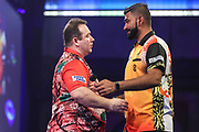 Brendan Dolan wins the first round match against Nitin Kumar  during the PDC William Hill World Darts Championship at Alexandra Palace, London, United Kingdom on 15 December 2019.
