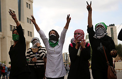 10.10.2015, Ramallah, PSE, Gewalt zwischen Palästinensern und Israelis, im Bild Zusammenstösse zwischen Palästinensischen Demonstranten und Israelischen Sicherheitskräfte // Palestinian girls flashe victory sign during clashes with Israeli security forces in Beit El on the outskirts of the West Bank city of Ramallah, on October 10, 2015. Fifteen Palestinians have been killed by Israeli forces and around 1,000 injured with live and rubber-coated steel bullets in the occupied West Bank and Gaza Strip since Oct. 1, Palestine on 2015/10/10. EXPA Pictures © 2015, PhotoCredit: EXPA/ APAimages/ Shadi Hatem<br /> <br /> *****ATTENTION - for AUT, GER, SUI, ITA, POL, CRO, SRB only*****