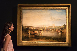 "© Licensed to London News Pictures. 29/06/2018. LONDON, UK. A staff member views ""Walton Bridges"" by J.M.W. Turner (Est. £3-5m).  Preview of Old Masters, British, Treasures, Sculptures and Ancient works at Sotheby's New Bond Street to be offered for sale on 3 and 4 July 2018.  Photo credit: Stephen Chung/LNP"