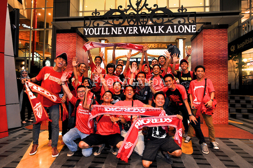 JAKARTA, INDONESIA - Thursday, July 18, 2013: Liverpool supporters pose under a replica Shankly Gates before a fans' event at the FX Senayan Centre ahead of Liverpool FC's visit to Indonesia as part of their Preseason Tour. (Pic by David Rawcliffe/Propaganda)
