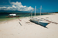 Philippines, Palawan. Bangka at Honda Bay beach.