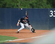 Mississippi's Matt Smith (16) fields a hit vs. Virginia during an NCAA Regional game at Davenport Field in Charlottesville, Va. on Saturday, June 5, 2010.