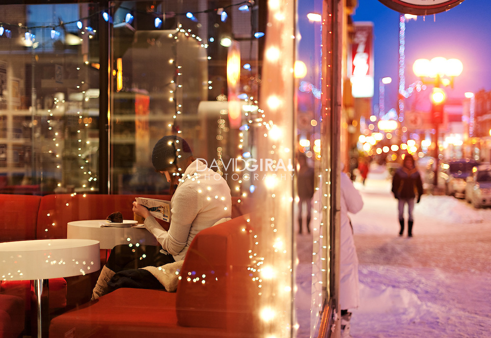 Editorial Travel Photography: The reading girl at the coffee shop, brulerie Saint Denis, Rosemont District, Montreal, Quebec