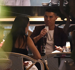 Cristiano Ronaldo and his girlfriend Georgina Rodriguez enjoy a evening at Zela restaurant in Covent Garden. Ronaldo is one of the financial backers of the venue, and seemed keen to check the place out, spending almost 4 hours inside. The pair were seen to consume several drinks each, and left around 2am, with their son, Cristiano Jr. Before they left, their friends took photos inside of the family, however Ronaldo posed with his hand wrapped around his sons throat. 14 Nov 2018 Pictured: Cristiano Ronaldo, Georgina Rodriguez. Photo credit: Will / MEGA TheMegaAgency.com +1 888 505 6342