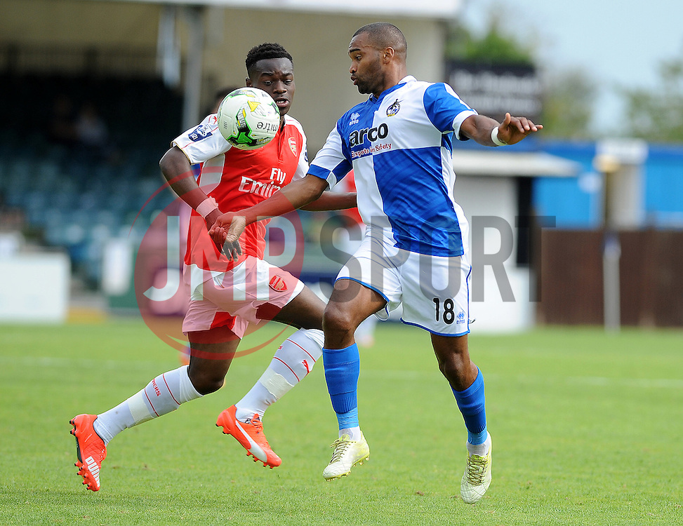 Jermaine Easter of Bristol Rovers is challenged by Arsenal's Marc Bola - Photo mandatory by-line: Neil Brookman/JMP - Mobile: 07966 386802 - 18/07/2015 - SPORT - Football - Bristol - Memorial Stadium - Pre-Season Friendly