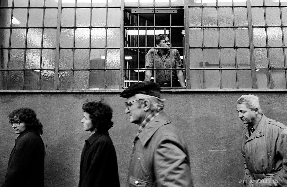 A worker leans out of the windows of the KD engineering works in Prague during the General Strike. Prague Nov 1989. Czechoslovakia