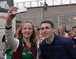 A Mayo fan gets a selfie with Patrick Durcan at the team&rsquo;s homecoming in McHale park yesterday.<br /> Pic Conor McKeown