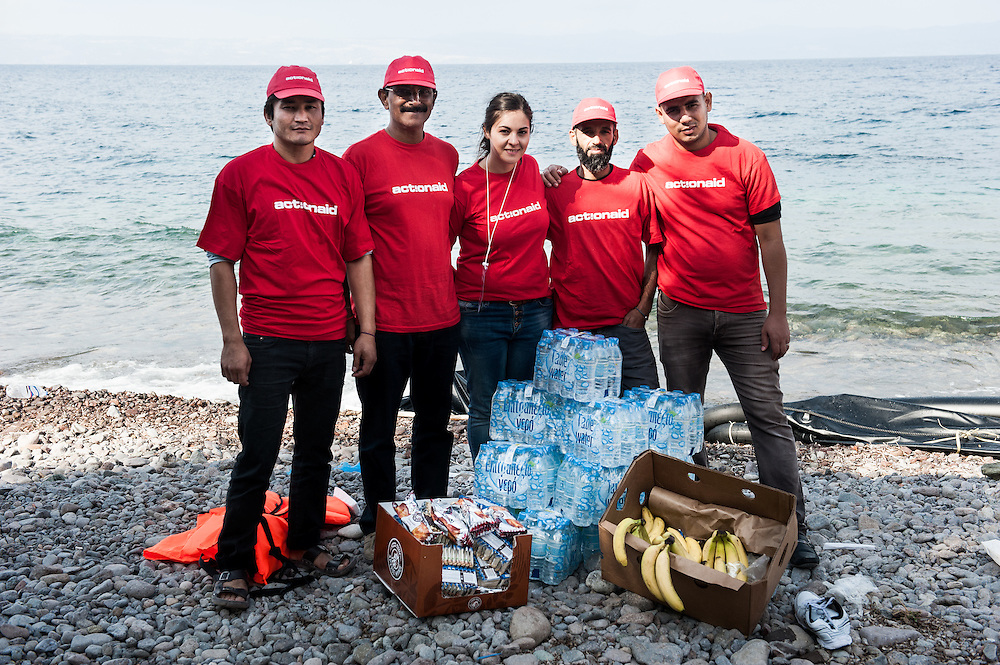 ActionAid's team in Lesvos Abbas, Amar, Constantina, Hamid and Moustafa infront of food and clothes given to newly arrived refugees and migrants. Skala Sykamias, Lesvos, Greece