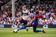 Mamadou Sakho (12) of Crystal Palace, Fulham (14) Andre Schurrle during the Premier League match between Fulham and Crystal Palace at Craven Cottage, London, England on 11 August 2018.