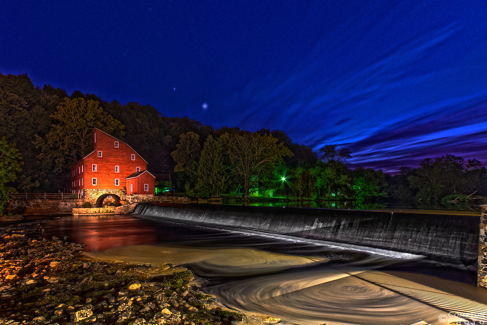 Venus setting behind the Red Mill in Clinton New Jersey on a warm summer night.