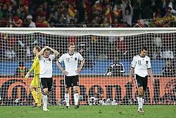 07-07-2010 VOETBAL: FIFA WORLDCUP 2010 SPANJE - DUITSLAND: DURBAN<br /> Halve finale WC 2010 - Spanje wint met 1-0 van Duitsland / nach dem 0:1 durch Puyol lassen die deutschen Spieler den Kop hängen Manuel Neuer ( FC Schalke 04 #01 ) Bastian Schweinsteiger ( FC Bayern Muenchen #07 ) Per Mertesacker ( Werder Bremen #17 ) Miroslav Klose ( FC Bayern Muenchen #11 )<br /> ©2010-FRH- NPH/ Kokenge (Netherlands only)