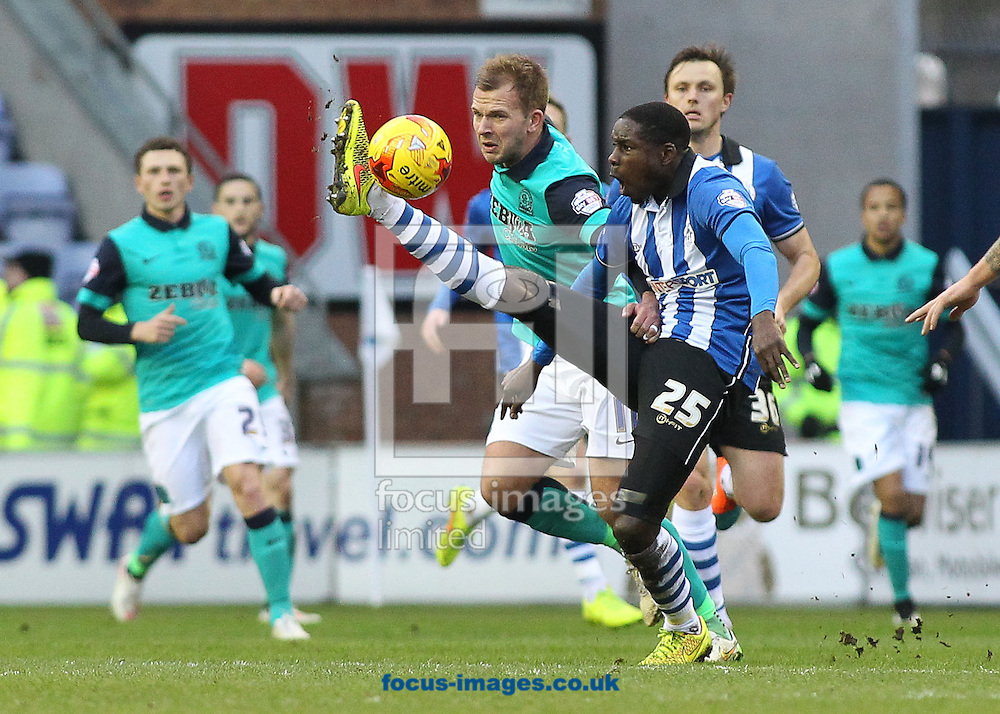 Leon Barnett of Wigan Athletic and Jordan Rhodes of Blackburn Rovers in action during the Sky Bet Championship match at the DW Stadium, Wigan.<br /> Picture by Michael Sedgwick/Focus Images Ltd +44 7900 363072<br /> 17/01/2015
