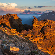 The distant Longs Peak catches the last light of day at Rocky Mountain National Park, Colorado.