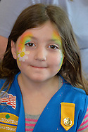 Wantagh, New York, USA. 7th February 2016. AYLA SHAH, 5, of Merrick, has a daisy rainbow painted on her face during the Open House at Last Hope Animal Rescue, during Hallmark Channel Kitten Bowl III. The adoption center's volunteers, including Ayla's mom, and visitors watch the game on TV and cheer on their team, the Last Hope Lions. Over 100 adoptable kittens from Last Hope Inc and North Shore Animal League America participated in the games, and the Home and Family Felines won the 2016 championship, which first aired the day of Super Bowl 50.