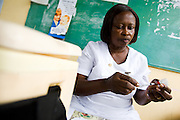 Nurse Rebecca Lartey prepares a pentavalent vaccine at the Osu Maternity Home in Accra, Ghana on Tuesday June 16, 2009.