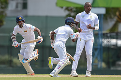 July 7, 2018 - Colombo, Western Province, Sri Lanka - Sri Lanka Borad Xl batsman Danushka Gunathilka (L) and Kaushal Silva (C) taking a single during the day one of a two-day practice match between the Sri Lanka Board XI and South African team at P Sara Oval grounds in Colombo on 7th July, 2018, South Africa will play two Test matches, five ODI's and one T20 match in Sri Lanka. The first Test will play on July 12 at the Galle International Cricket Stadium in Galle. (Credit Image: © Sameera Peiris/Pacific Press via ZUMA Wire)