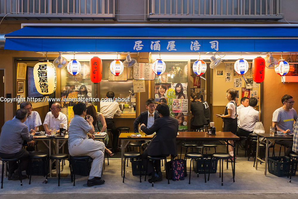 Small outdoor restaurant on street in the evening in Rokku entertainment district of Asakusa adjacent to SensoJi shrine in Tokyo Japan