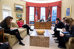 President Barack Obama talks on the phone with Chancellor Angela Merkel of Germany in the Oval Office, March 27, 2015. Attendees from left are Sahar Nowrouzzadeh, Director for Iran; National Security Advisor Susan E. Rice; Phil Gordon, White House Coordinator for the Middle East, North Africa, and the Gulf Region; Charles Kupchan, Senior Director for European Affairs and Avril Haines, Deputy National Security Advisor. (Official White House Photo by Pete Souza)<br /> <br /> This official White House photograph is being made available only for publication by news organizations and/or for personal use printing by the subject(s) of the photograph. The photograph may not be manipulated in any way and may not be used in commercial or political materials, advertisements, emails, products, promotions that in any way suggests approval or endorsement of the President, the First Family, or the White House.